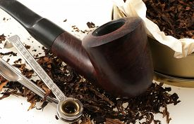 pic of tobacco-pipe  - pipe with round box of tobacco and accessories