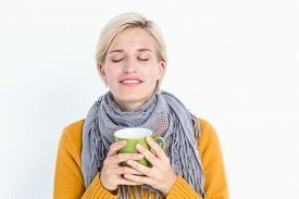 picture of feeling better  - Close up of woman drinking from a cup to feel better - JPG