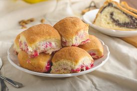 stock photo of grandma  - Poppy seeds cake stuffed buns homemade like from grandma - JPG