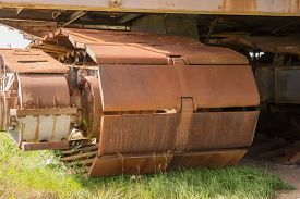 image of backhoe  - Rusty wheels of big backhoe in nature - JPG