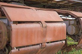 pic of backhoe  - Rusty wheels of big backhoe in nature - JPG