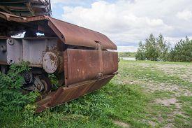 foto of backhoe  - Rusty wheels of big backhoe in nature - JPG