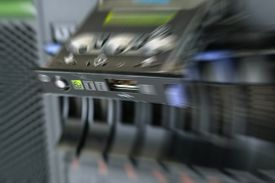 picture of raid  - Blurred zoom of Computer Server with panel and raid storage in datacenter - JPG