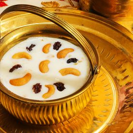 foto of pal  - Pudding Pal Payasam Kheer Indian food garnished with cashew and raisin Side View - JPG