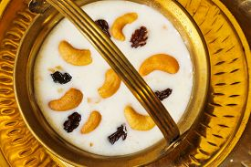 image of pal  - Pudding Pal Payasam Kheer Indian food garnished with cashew and raisin Top View - JPG