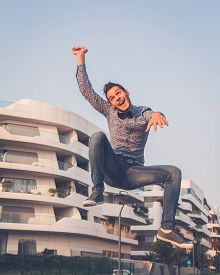 image of bow tie hair  - Young handsome man with short hair wearing a bow tie and jumping in the city streets  - JPG