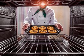 image of pastry chef  - Chef prepares pastries in the oven - JPG