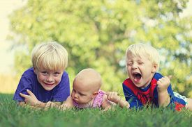 image of three sisters  - Three silly and happy young siblings - JPG