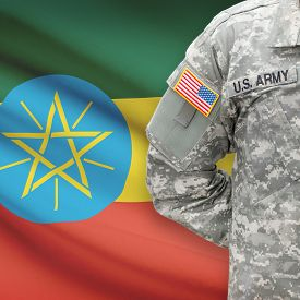 stock photo of ethiopia  - American soldier with flag on background series  - JPG