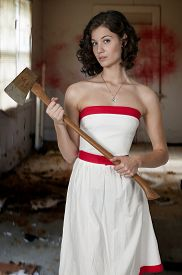 pic of possession  - Beautiful possessed woman in a trance holding an axe - JPG