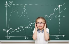 stock photo of horrifying  - girl horrified by the graphic drawing on school board - JPG