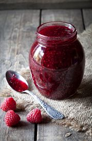 foto of jar jelly  - Raspberry jam sweet jelly preserve in mason jar - JPG