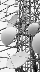 stock photo of wiretap  - large telecommunications antennas and repeaters of television and telephone signals - JPG