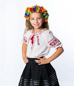 image of national costume  - happy little Ukrainian  girl in the national costume - JPG