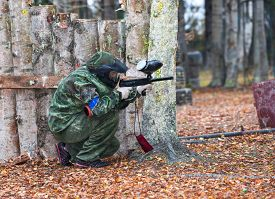image of paintball  - Young Paintball Player Shooting from paintball marker - JPG