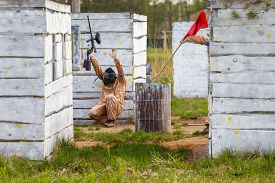 picture of paintball  - Extreme capture of red flag in paintball game - JPG