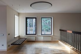 picture of suspenders  - Interior of modern empty space with suspended bench and big windows - JPG