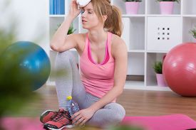 picture of fatigue  - Training at home was very fatiguing for young woman - JPG