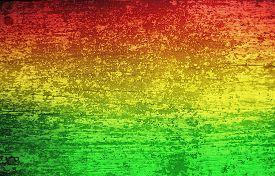 image of reggae  - Green red yellow grunge wood background  - JPG
