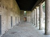 image of slave-house  - Hallway leading along Gladiator Quarters in Pompei - JPG