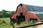 stock photo of wanton  - An old barn with the true shape to be an Americana landmark - JPG