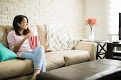 Hispanic Woman Watching Movies By Herself poster