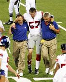 EAST RUTHERFORD, NJ - AUGUST 16: New York  Giants linebacker Chase Blackburn is injured while playin