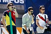 FLUSHING, NY - AUGUST 28: The Jonas Brothers perform at Arthur Ashe Kids' Day at the Billie Jean King National Tennis Center on August 28, 2010 in Flushing, New York.