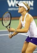 FLUSHING, NY - SEPTEMBER 4: Melanie Oudin (USA) waits for serve during mixed doubles at the US Open Tennis Tournament at Billie Jean King National Tennis Center on September 4, 2010 in Flushing, NY.