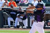 SCOTTSDALE, AZ - MARCH 7: Colorado Rockies infielder Hernan Iribarren takes a swing at a spring trai