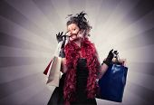Elegant woman carrying some shopping bags
