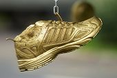 Golden Running Shoes