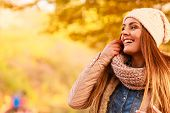 Smiling Woman Relaxing Outdoor In Autumnal Park poster