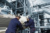 stock photo of factory-worker  - industrial oil and gas refinery - JPG