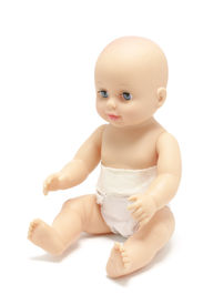 stock photo of baby doll  - A baby doll sitting on isolated white background - JPG