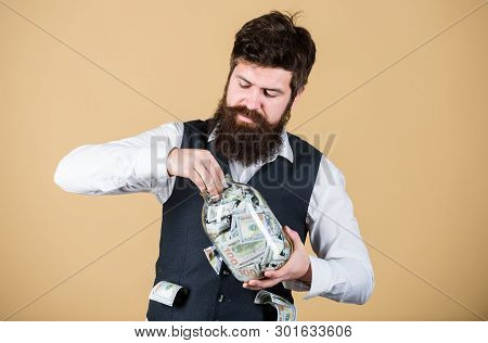 poster of Making An Investment. Businessman Taking Cash Money Out Of Glass Jar For Investing Activities. Beard