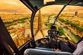 Helicopter Cockpit Flying At Sunset On Notre Dame De Paris Cathedral And On Skyline Of Paris, French poster