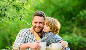 Healthy Food. Father And Boy Drink Tea Outdoors. Develop Healthy Eating Habits. Feed Baby. Natural N poster