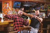 Cheers Concept. Hipster Brutal Bearded Man Drinking Alcohol With Friend At Bar Counter. Men Drunk Re poster