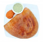 stock photo of urad  - Golden masala dosa with two different chutneys on a plate isolated on white with clipping mask - JPG