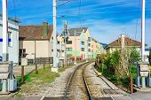 Railway In Stanserhorn In Switzerland. Industrial Landscape With Railway Station, Colorful Blue Sky, poster