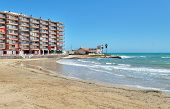 High Rise Building Near The Mediterranean Sea, Sandy Beach Coastline Of Playa Del Cura In Torrevieja poster