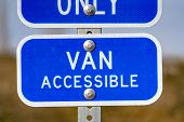 Blue Sign With A Van Accessible Text On A Parking Area For Handicapped People poster