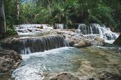 Deep Forest Waterfall At Erawan Waterfall National Park. Long Exposure. Beautiful Scenery. Waterfall poster