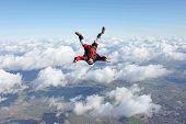 Skydivers falls head down
