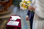 Bouquet Of Flowers In The Hand Of The Bride During The Marriage Ceremony poster