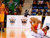 KUALA LUMPUR - FEBRUARY 19: Malaysian Dragons' Brian Williams falls from a foul at the ASEAN Basketb