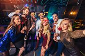 Group Of Friends Partying In A Nightclub Make Selfie Photo poster