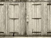 Monochrome Old Rural Grey Plank Wooden Plank Doors With A Bolt Fastening And Rusty Iron Hinges poster