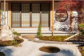 Traditional Japanese Courtyard With Rock Garden. Japanese Garden. Cozy Picturesque Japanese Garden.  poster
